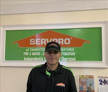 Technician in front of SERVPRO sign